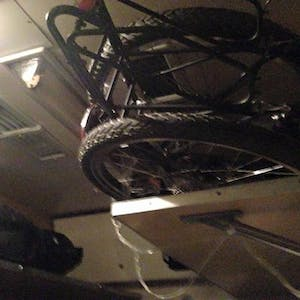 View enlargement of My bike doesn't really fit on a high shelf.
