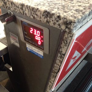 View enlargement of The LED readout at the check-in counter reads 23.0kg.