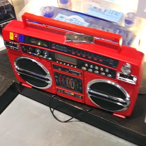 A large red ghetto blaster.