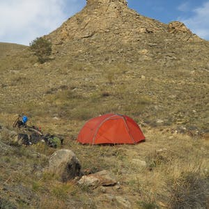 View enlargement of The tent and behind it the rocky knoll.