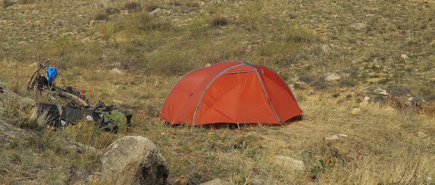 The tent and behind it the rocky knoll.