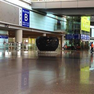 A large pot sculpture inside the terminal.