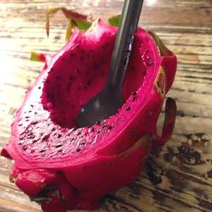 A half eaten Dragon fruit.