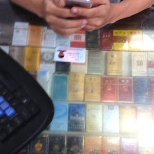 A Chinese ID and many cigarette packets.