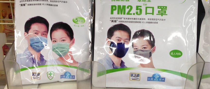 A man and a woman wear face masks on product packaging.