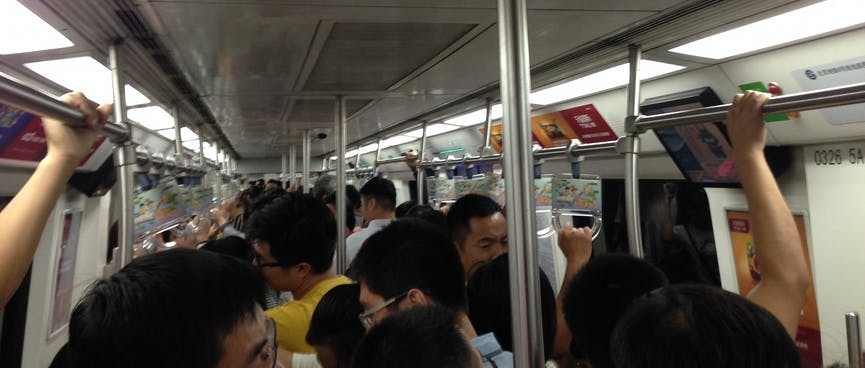 Looking down on Chinese people while riding the subway.