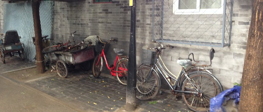 Ladies bicycles and a cart with bicycle wheels.