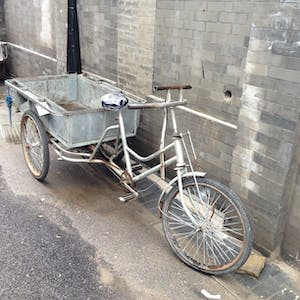 View enlargement of A long trike has room for a large tray on the back.