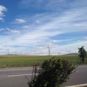 View enlargement of Fields of wind turbines spin in the strong breeze.