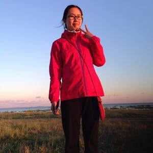 View enlargement of Mandy's pink jacket matches the pink hue on the horizon.