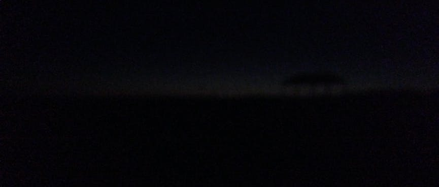 As night falls, the horizon is only barely visible.