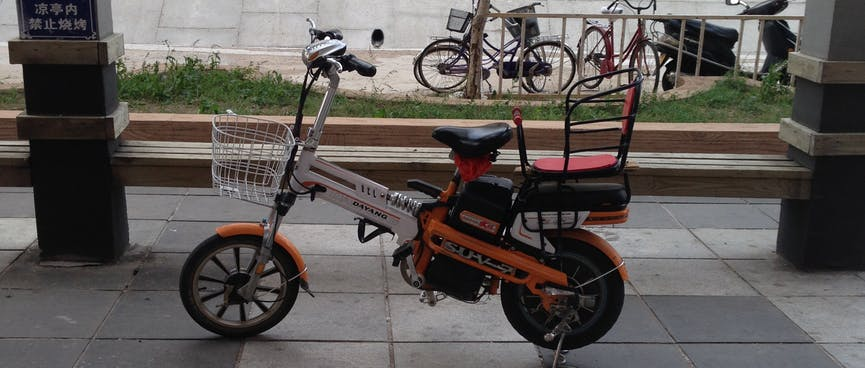 An electric scooter looks like a trigger happy pistol.