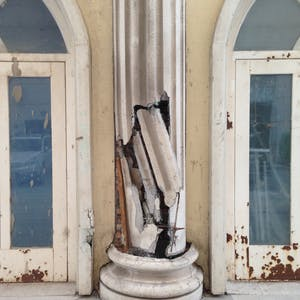 View enlargement of Cracked plastic reveals a less substantial side to a classical column.