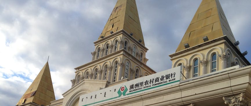 Steeples adorn the roof of the local bank.