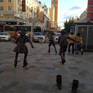 View enlargement of Bronze statues of skaters really look like they are moving - quickly!
