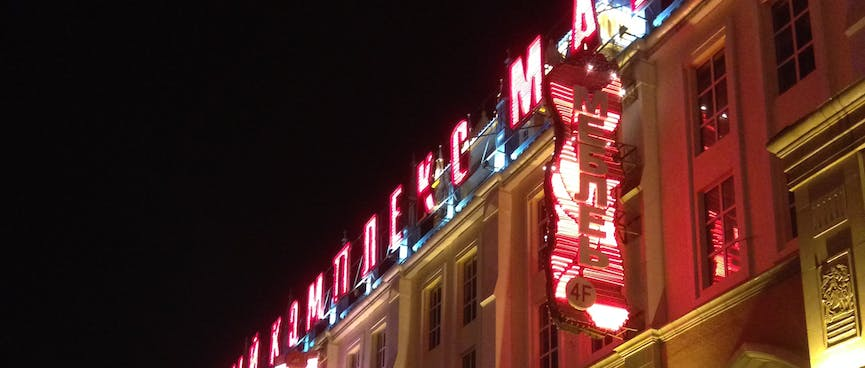 Red LED lettering on top of the local shopping center.