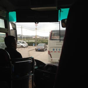 View enlargement of Our tour bus driver negotiates traffic.