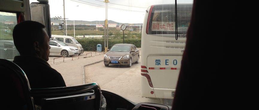Our tour bus driver negotiates traffic.