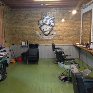 View enlargement of A row of barber chairs, an old motorcycle, and a illustration of a heart and two hands shaking.