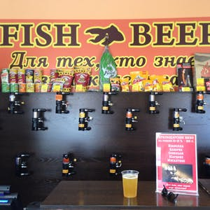 View enlargement of Beer taps cover a wall under a large sign stating FISH BEER, in Chita.