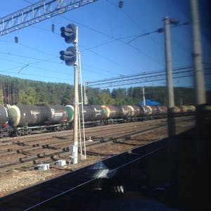 View enlargement of A long line of cylindrical wagons.
