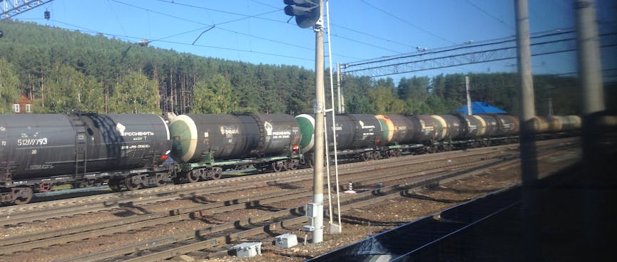 A long line of cylindrical wagons.