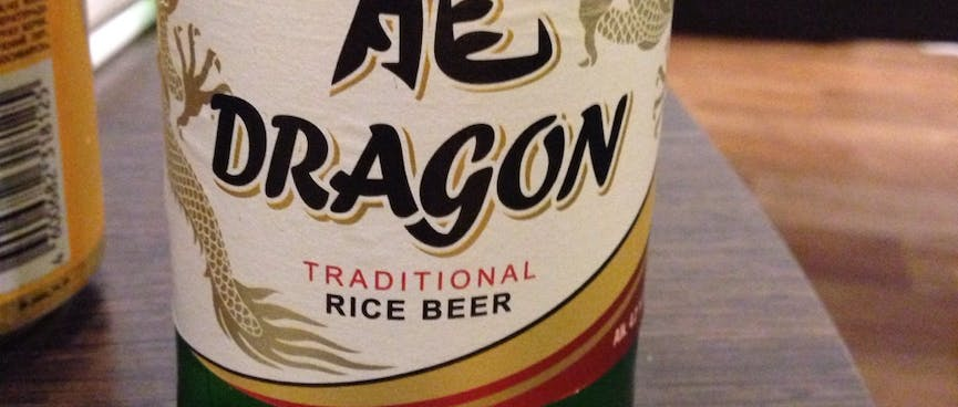 A bottle of Dragon Traditional Rice Beer.