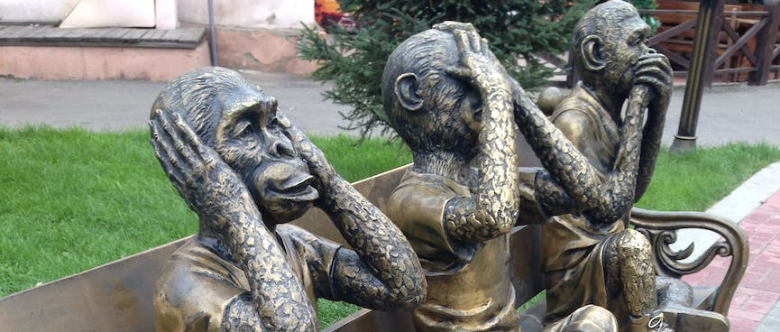 Three bronze monkeys act cover their ears, eyes and mouth, in Irkutsk.