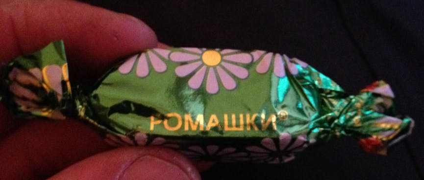 A chocolate is wrapped in floral foil.