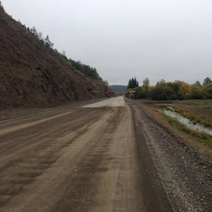 View enlargement of The dirt road becomes sealed.