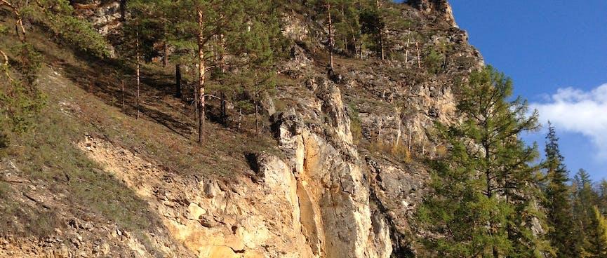 A rocky hill erodes in a landslide.