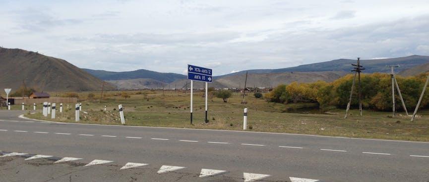 A Cyrillic sign translates to Ust-Anga 12km, Anga 5km.