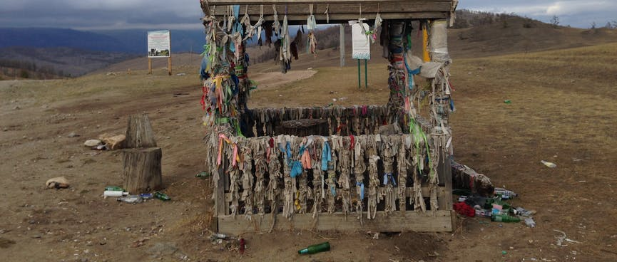 Ribbons hanging from all corners of a small shelter.