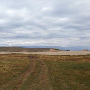 View enlargement of A grassy track passes a sandbar.