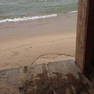 View enlargement of The sandbar from a raised wooden platform.