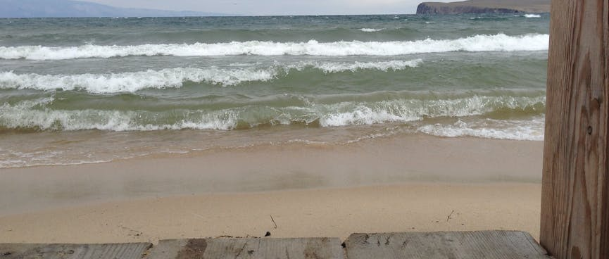 Waves break on the sandbar.