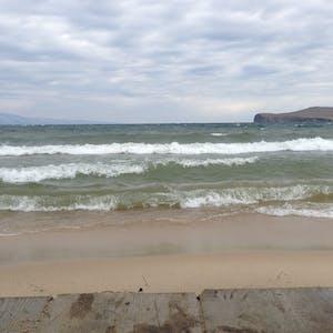 View enlargement of Waves break on the sandbar.