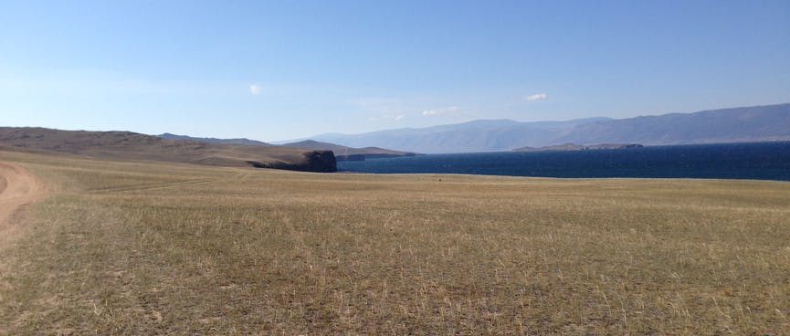 Steppes, cliffs, and the lake below.