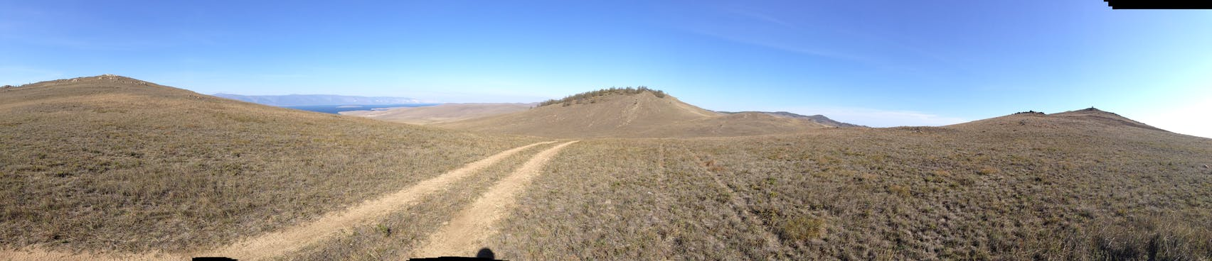 Hills flank the hilltop trail.