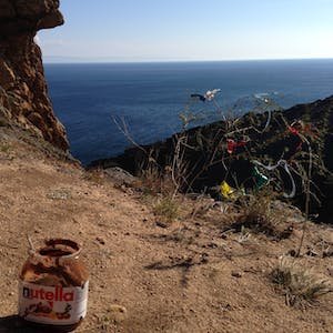 View enlargement of Lake Baikal, prayer flags and a jar of Nutella.