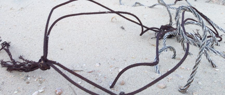 Wire lies in the sand.