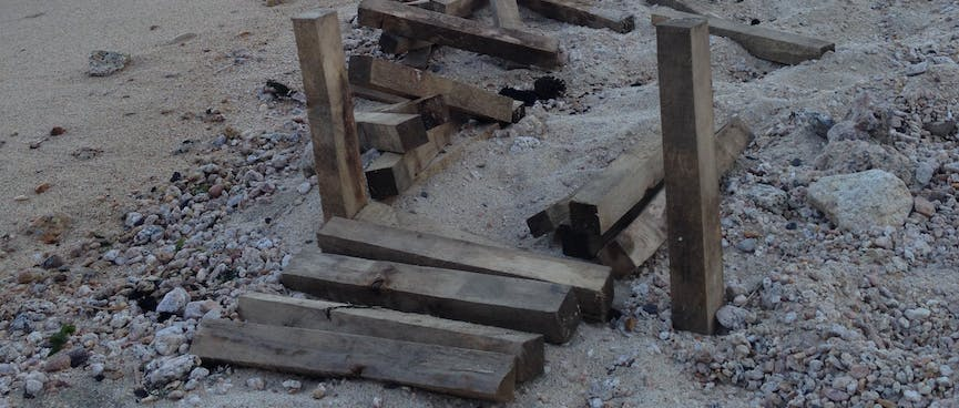 Two wooden posts and a couple of planks.