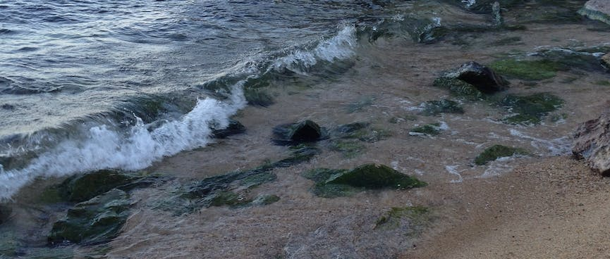 Shards of rock spill into the sea.