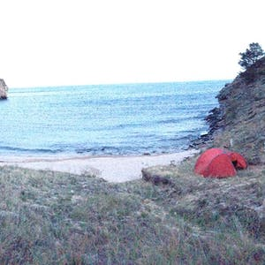 View enlargement of My orange tent is nestled into the right side of the bay.