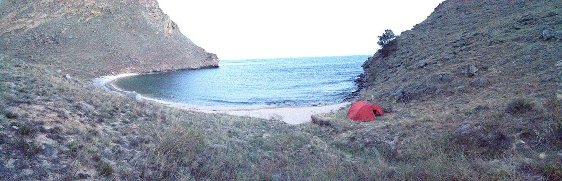 My orange tent is nestled into the right side of the bay.
