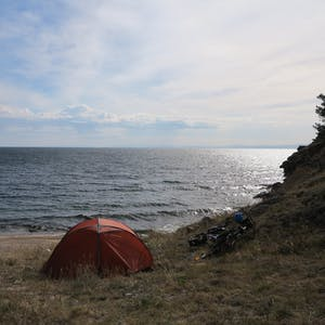 View enlargement of Looking over the tent to the sea beyond.