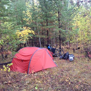 View enlargement of My wet tent in the thick forest.