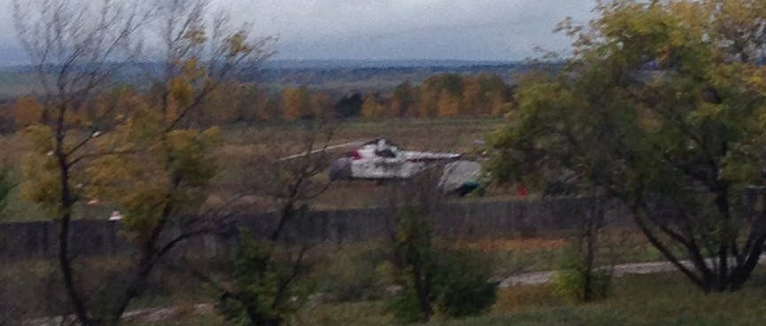At the Oyok Airfield, a large white helicopter looks like the Sikorsky S-58T used in the TV Series Riptide.
