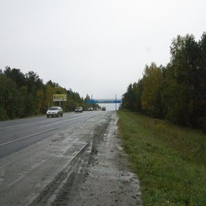 View enlargement of A blue Irkutsk sign straddles the highway at the city limits.
