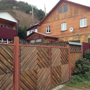 View enlargement of A fence is decorated with diagonal wooden slats.